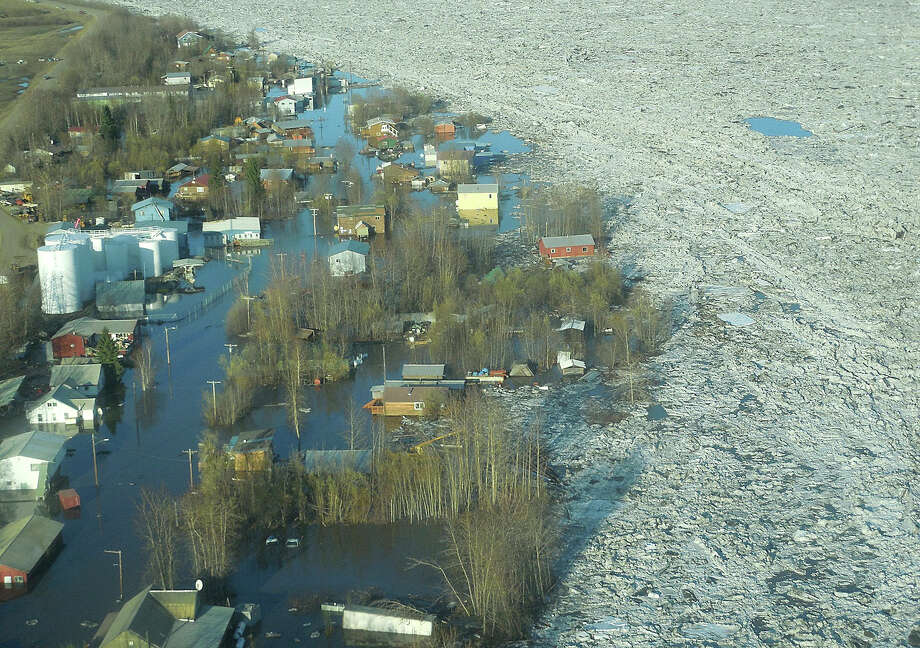 In this May 27, 2013 photo released by the National Weather Service, ice and water are shown flooding homes and other buildings in Galena, Alaska. Several hundred people are estimated to have fled the community of Galena in Alaska's interior, where a river ice jam has caused major flooding, sending water washing over roads and submerging buildings. Photo: AP