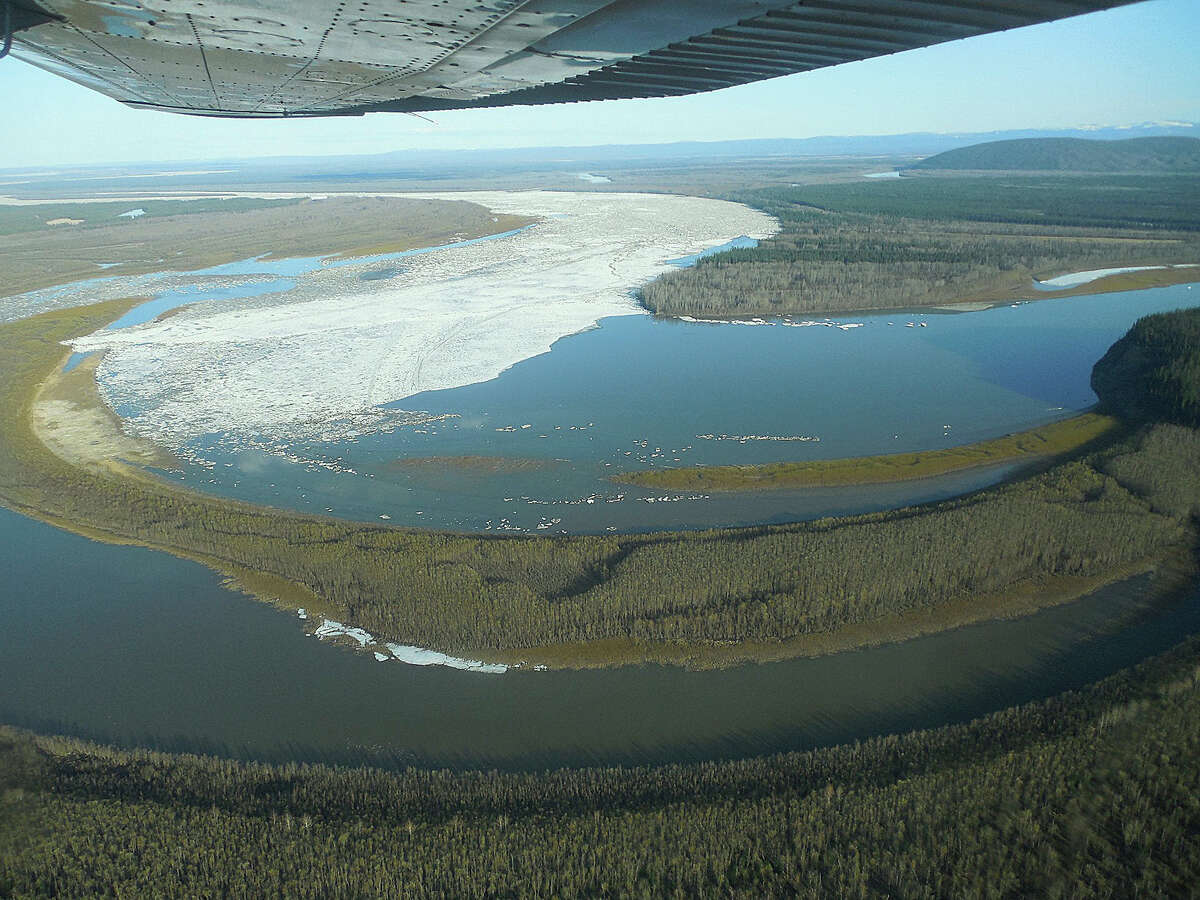 In this May 27, 2013 photo released by the National Weather Service, the ice jam on the Yukon River at Bishop Rock is shown in Galena, Alaska. Several hundred people are estimated to have fled the community of Galena in Alaska's interior, where a river ice jam has caused major flooding, sending water washing over roads and submerging buildings.