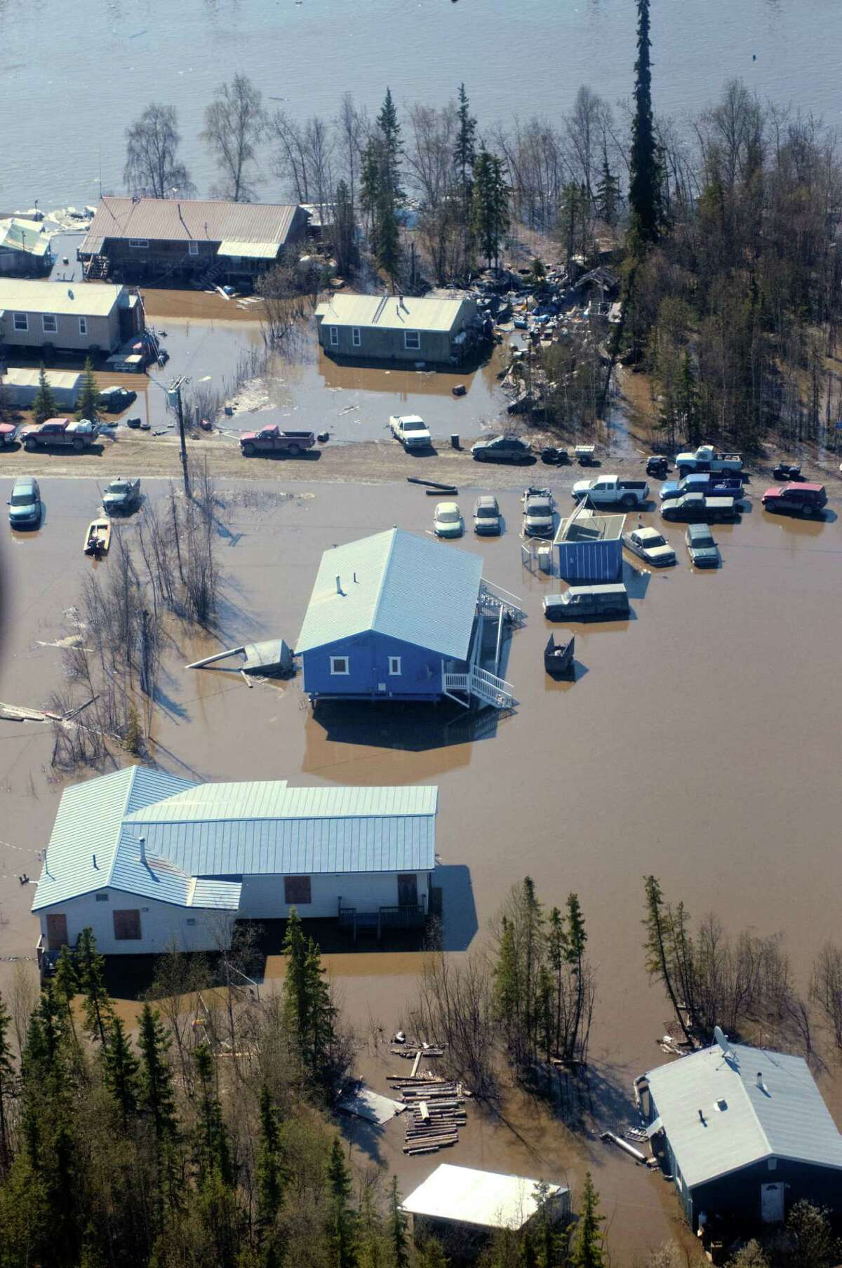 In this May 28, 2013 photo, the town of Galena, Alaska is flooded by the Yukon River during the breakup of winter ice. Several hundred people are estimated to have fled the community of Galena in Alaska's interior, where a river ice jam has caused major flooding, sending water washing over roads and submerging buildings.