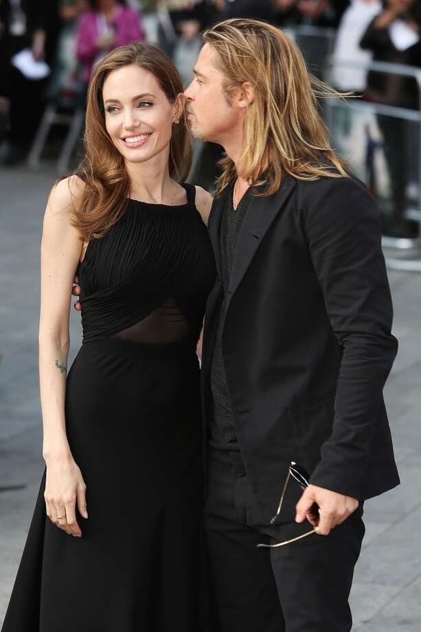 Angelina Jolie and Brad Pitt attend the World Premiere of 'World War Z' at The Empire Cinema on June 2, 2013 in London, England.  (Photo by Tim P. Whitby/Getty Images)