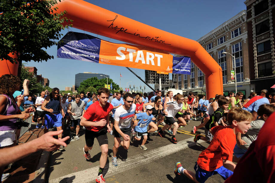 Runners begin the 5k portion of the Hope in Motion walk/run/ride to benefit Stamford Hospital's Bennett Cancer Center at Columbus Park in downtown Stamford on Sunday, June 2, 2013. Photo: Jason Rearick / Stamford Advocate