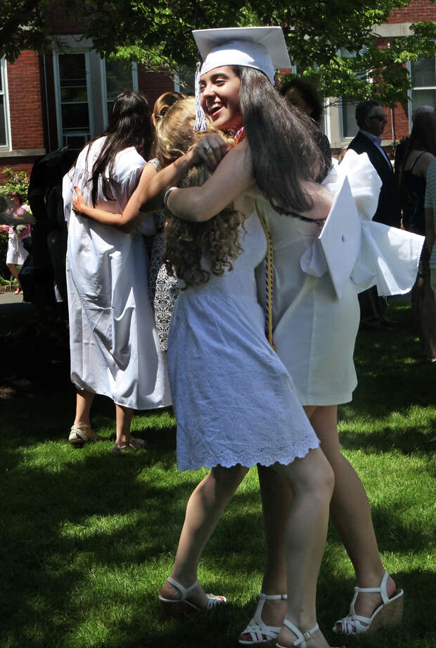 Lauralton Hall graduates, Caleigh O'Leary,of Fairfield, left, and Alexandra Torres, of Bridgeport, celebrate after commencement exercises on Sunday, June 2, 2013 in Milford, Conn. Photo: BK Angeletti, B.K. Angeletti / Connecticut Post freelance B.K. Angeletti