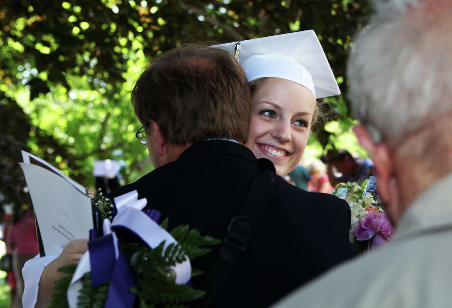 Lauralton Hall graduate, Jill Murray, of Trumbull, gets a hug from her father Ross after commencement exercises on Sunday, June 2, 2013 in Milford, Conn. Photo: BK Angeletti, B.K. Angeletti / Connecticut Post freelance B.K. Angeletti
