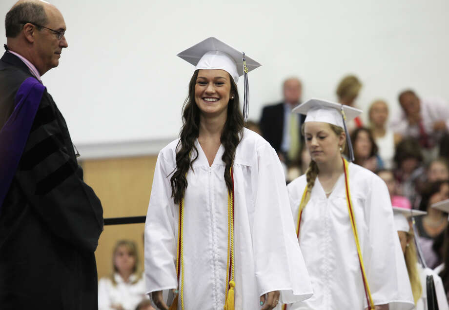 Rebecca Morgan, of Orange, receives her diploma during Lauralton Hall's commencement exercises on Sunday, June 2, 2013 in Milford, Conn. Photo: BK Angeletti, B.K. Angeletti / Connecticut Post freelance B.K. Angeletti