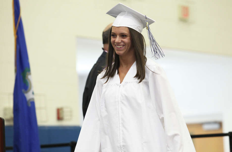 Staci D'Andrea, of Milford, receives her diploma during Lauralton Hall's commencement exercises on Sunday, June 2, 2013 in Milford, Conn. Photo: BK Angeletti, B.K. Angeletti / Connecticut Post freelance B.K. Angeletti