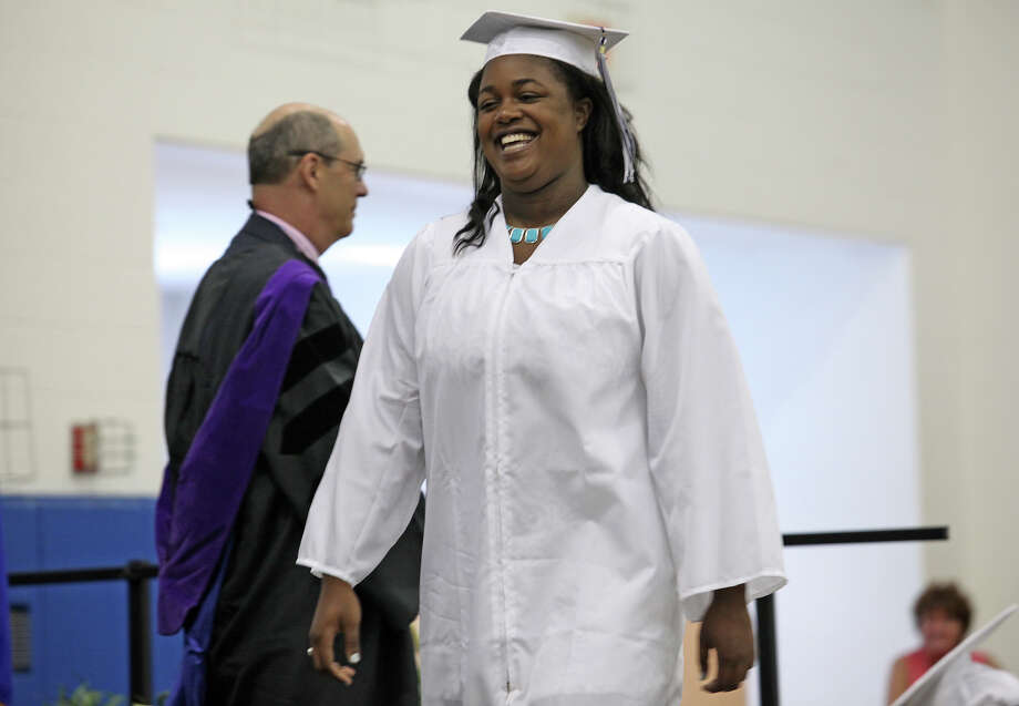 Sydney Free, of Stamford,  receives her diploma during Lauralton Hall's commencement exercises on Sunday, June 2, 2013 in Milford, Conn. Photo: BK Angeletti, B.K. Angeletti / Connecticut Post freelance B.K. Angeletti