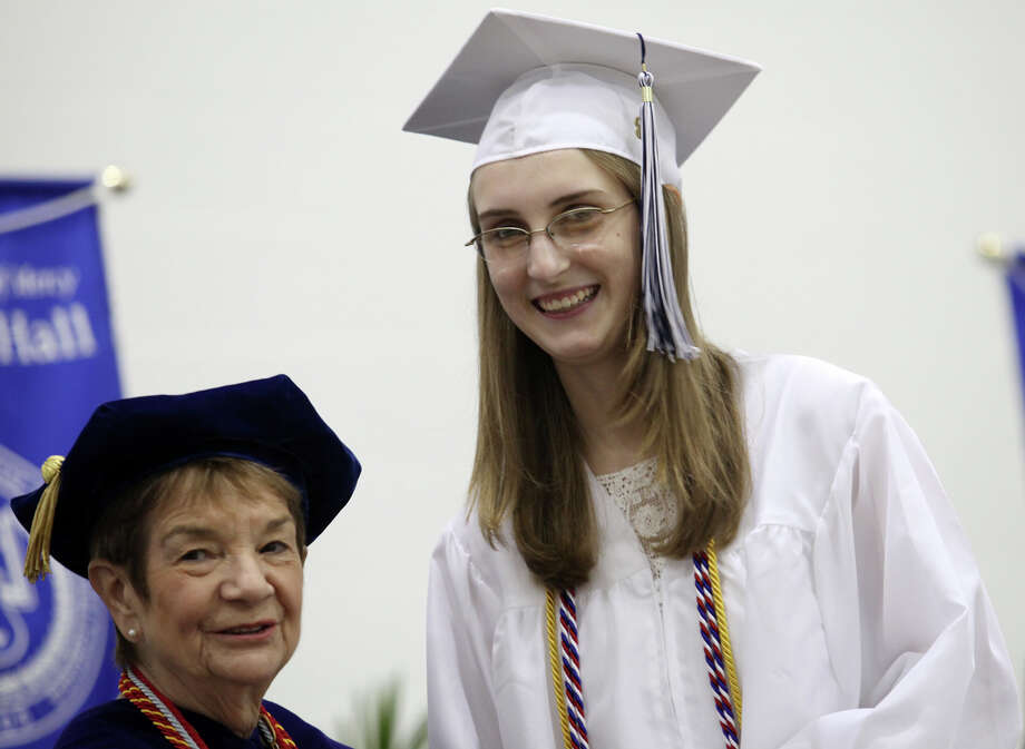 Catherine Gulish receives her diploma from President Antoinette Iadarola during Lauralton Hall's commencement exercises on Sunday, June 2, 2013 in Milford, Conn. Photo: BK Angeletti, B.K. Angeletti / Connecticut Post freelance B.K. Angeletti