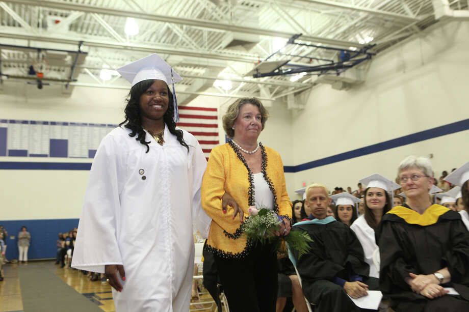 Graduate Rajane Brown, of Stratford, escorts alumna Carol DeLuca Hemmenway, of Fairfield,      to the stage during Lauralton Hall's commencement exercises on Sunday, June 2, 2013 in Milford, Conn. Photo: BK Angeletti, B.K. Angeletti / Connecticut Post freelance B.K. Angeletti