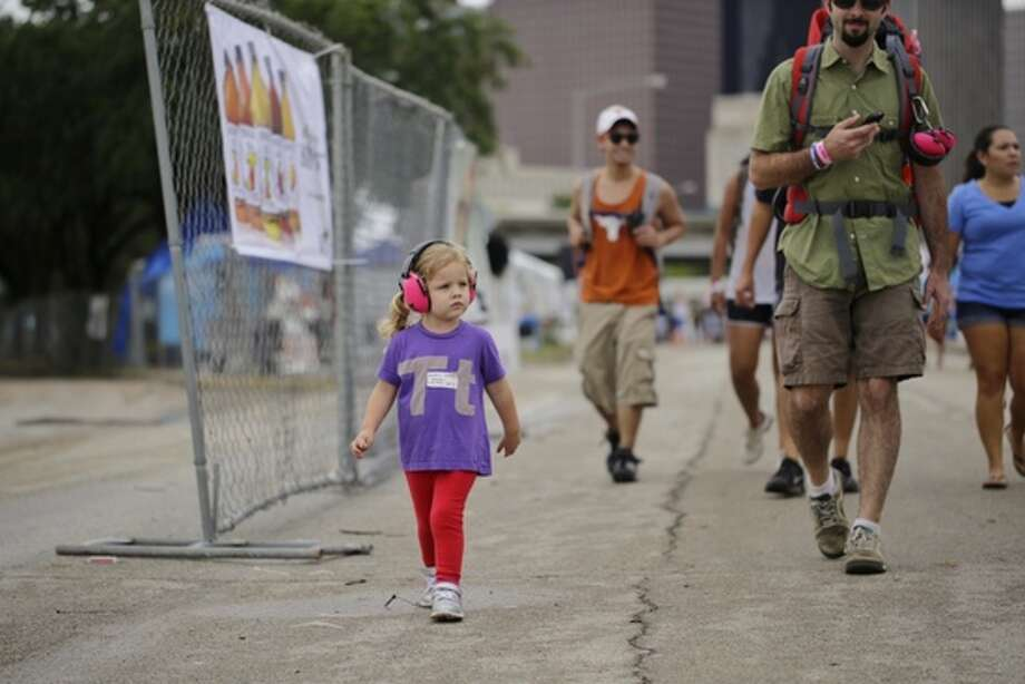 Three-year-old Stella Toch of Spring arrives for Day 2 of Free Press Summer Fest. Photo: Todd Spoth / For The Chronicle, ALL RIGHTS RESERVED832-265-3486 / ALL RIGHTS RESERVED 832-265-3486