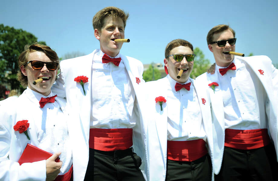 From left; Graduates Tim Edmonds, Riley Hoffman, Ryan Orvis, and Strecker Backe, pose for picture with cigars following Commencement Exercises at Fairfield Prep in Fairfield, Conn. on Sunday, June 2, 2013. Photo: Brian A. Pounds / Connecticut Post