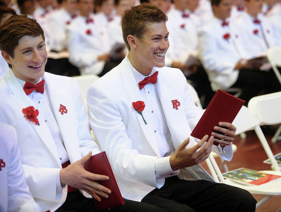 Grads Scott Ball, left, and Grayson Barlow admire their diplomas during Commencement Exercises at Fairfield Prep in Fairfield, Conn. on Sunday, June 2, 2013. Photo: Brian A. Pounds / Connecticut Post