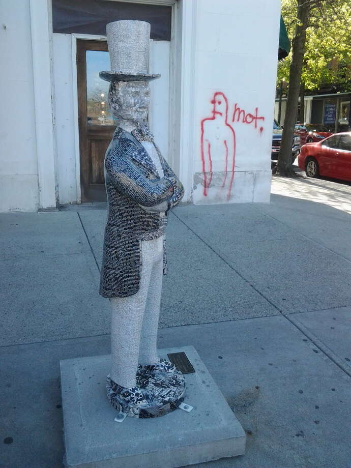 On May 3, 2013, Troy police said graffiti was spray painted near several of the Uncle Sam statues recently installed around Troy. (Troy Police Department)