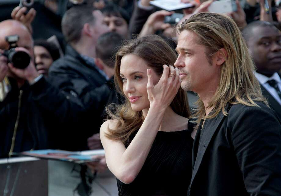 Brad Pitt and Angelina Jolie arrive for the World Premiere of World War Z at a central London cinema, Sunday, June 2, 2013. Photo: AP