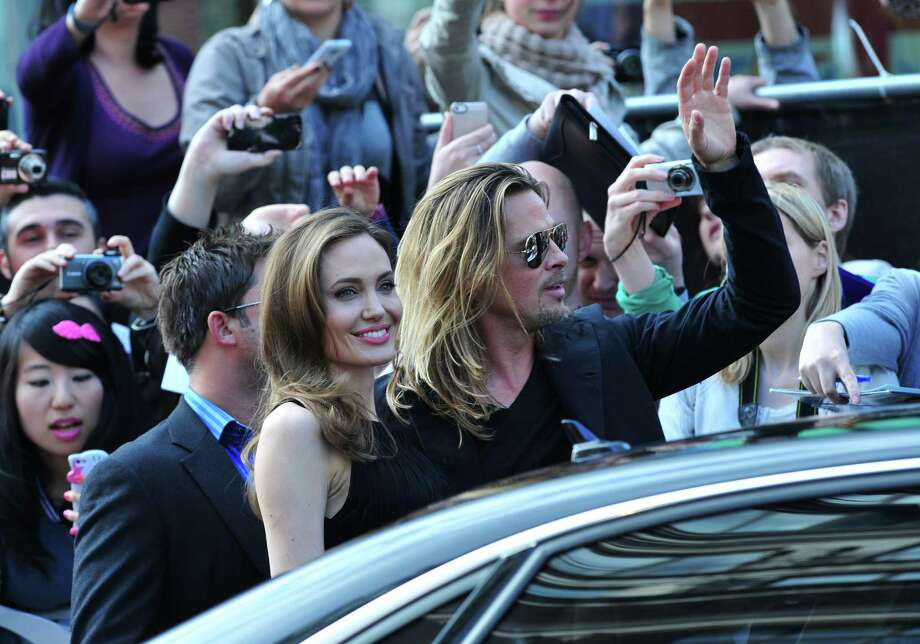Angelina Jolie and Brad Pitt arrive at the World Premiere of 'World War Z' at the Empire Cinema in London on Sunday June 2nd, 2013. Photo: AP