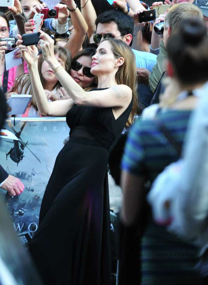 Angelina Jolie greets fans at the World Premiere of 'World War Z' at the Empire Cinema in London on Sunday June 2nd, 2013. Photo: AP