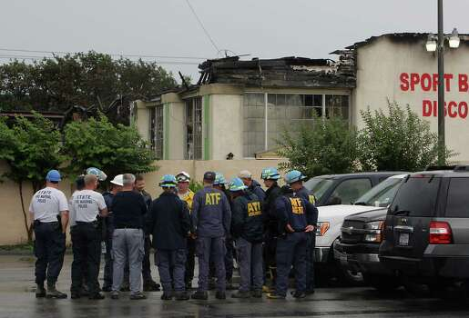 Federal and State officials work at the scene of Friday's deadly fire which claimed the lives of four Houston Fire Department firefighters Sunday, June 2, 2013, in Houston. (AP Photo/Houston Chronicle, James Nielsen) Photo: James Nielsen, Associated Press / Houston Chronicle