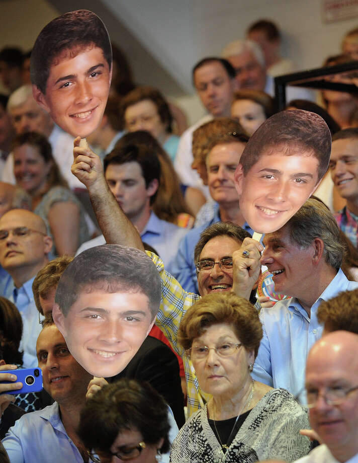 Relatives of graduate Tommy Cunningham, of Fairfield, hold up fans with his image on them during Commencement Exercises at Fairfield Prep in Fairfield, Conn. on Sunday, June 2, 2013. Photo: Brian A. Pounds / Connecticut Post