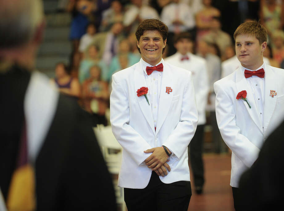 Graduating senior Troy Foreit, left, smiles as he processes to his seat during Fairfield Prep Commencement Exercises in Fairfield, Conn. on Sunday, June 2, 2013. Photo: Brian A. Pounds / Connecticut Post