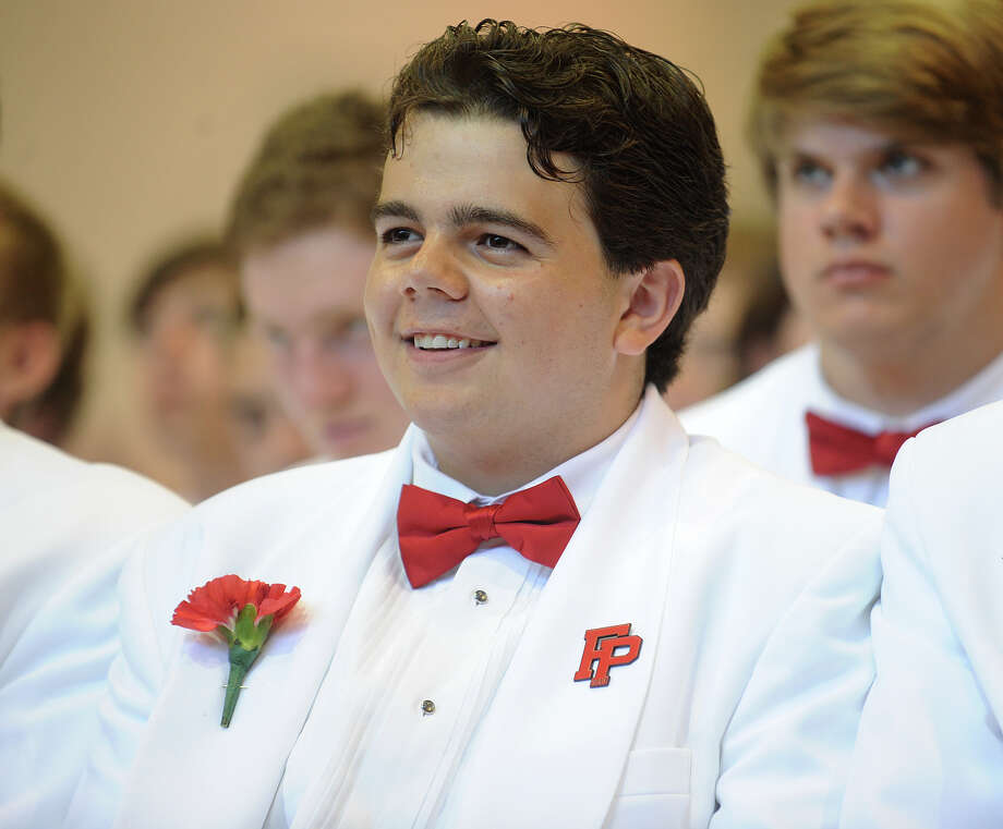 Graduating senior Timothy Attolino, Jr. smiles during Fairfield Prep Commencement Exercises in Fairfield, Conn. on Sunday, June 2, 2013. Photo: Brian A. Pounds / Connecticut Post