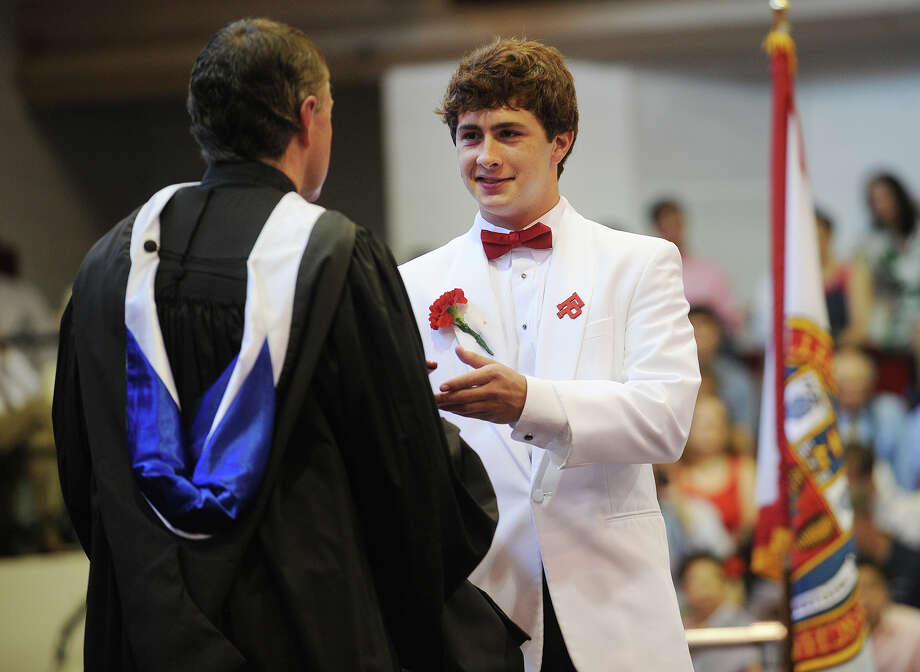 Thomas Cunningham of Fairfield receives his diploma during the Fairfield Prep Commencement Exercises in Fairfield, Conn. on Sunday, June 2, 2013. Photo: Brian A. Pounds / Connecticut Post