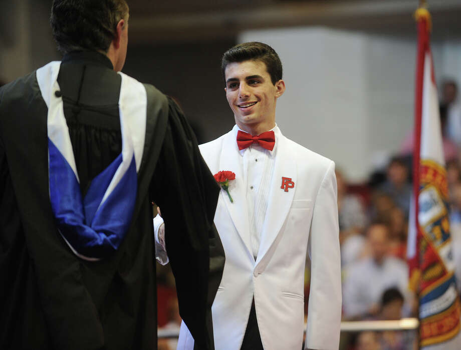 Alex Slossberg receives his diploma during Fairfield Prep Commencement Exercises in Fairfield, Conn. on Sunday, June 2, 2013. Photo: Brian A. Pounds / Connecticut Post