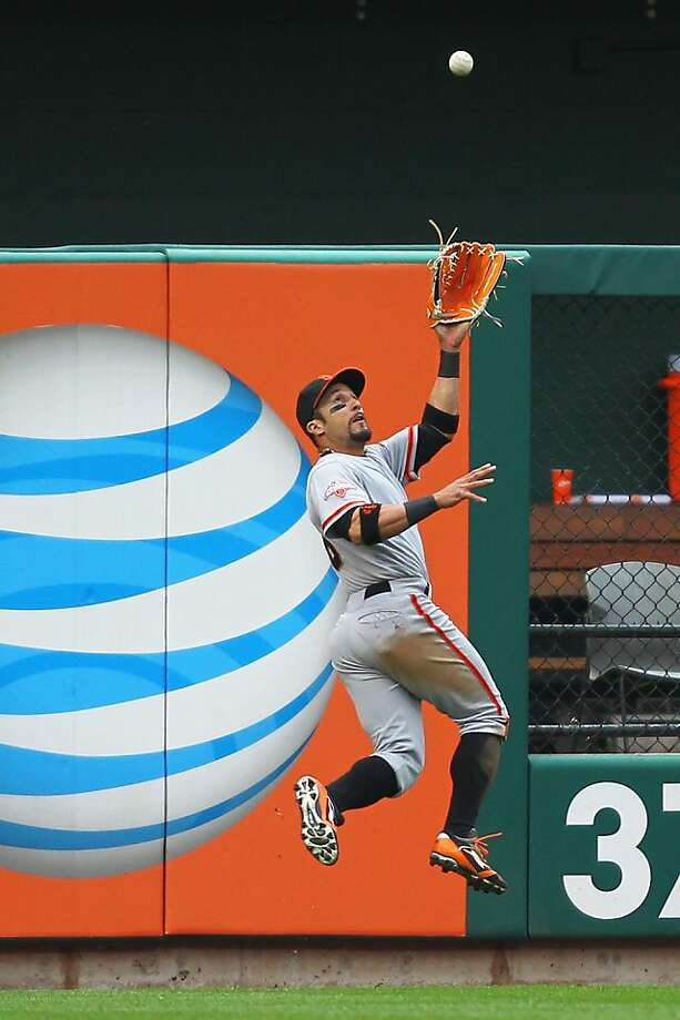 ST. LOUIS, MO - JUNE 2: Andres Torres #56 of the San Francisco Giants catches a deep fly ball against the St. Louis Cardinals in the eighth inning at Busch Stadium on June 2, 2013 in St. Louis, Missouri.  The Giants beat the Cardinals 4-2.  (Photo by Dilip Vishwanat/Getty Images) Photo: Dilip Vishwanat, Getty Images