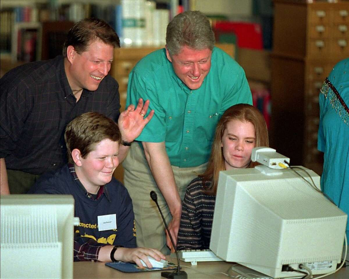 Vice President Al Gore and President Clinton watch Julie Allen, right, and Luke Rockwell on the computer at Ygnacio Valley High School in Concord, Calif., Saturday, March 9, 1996. Clinton and Gore were participating in NetDay96. (AP Photo/Denis Paquin)
