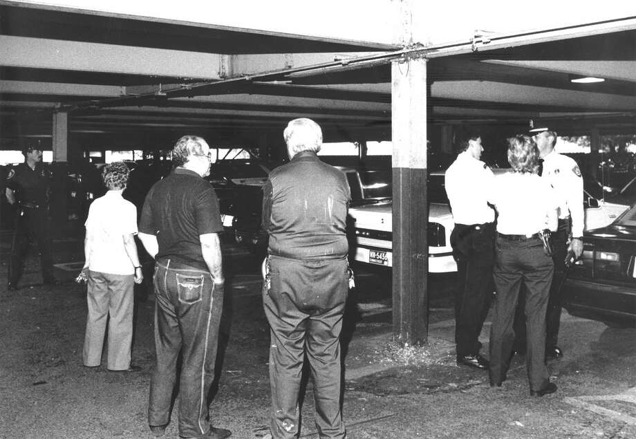Police and others gather in the Bloomingdale's parking garage, where a 61-year-old New Canaan woman was stabbed to death on June 6, 1988. Photo: File
