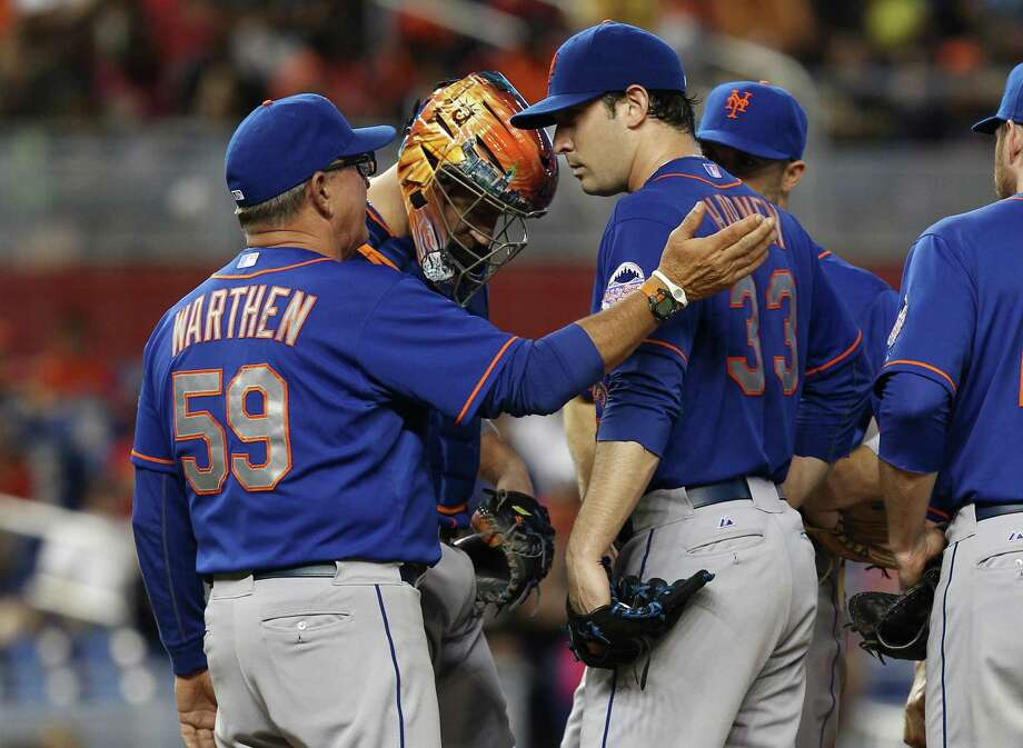 New York Mets pitching coach Dan Warthen (59) talks to starter Matt Harvey (33) during the fifth inning of a baseball game  against the Miami Marlins in Miami, Sunday, June 2, 2013. The Marlins won 11-6.  (AP Photo/J Pat Carter) Photo: J Pat Carter