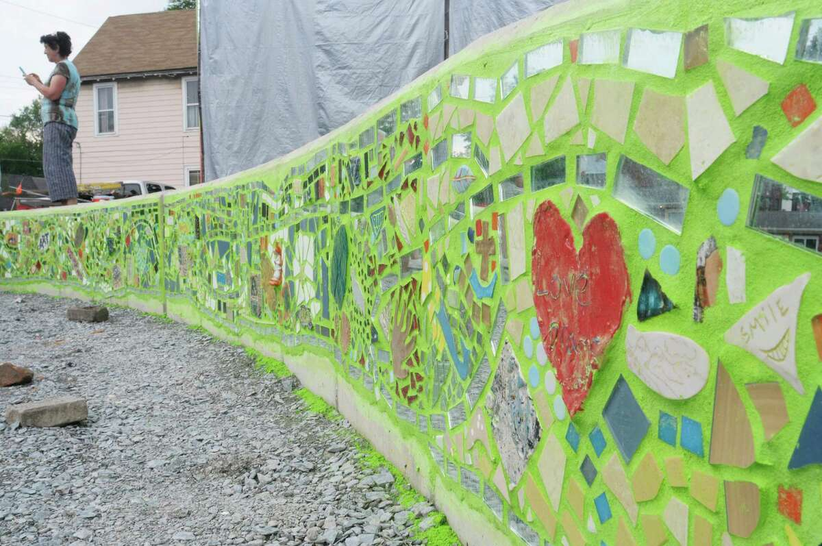 A view of the front of the stage with mosaic artwork at the Freedom Square Art Stage on Sunday, June 2, 2013 in Troy, NY. The creation of the art stage and mosaic wall is a project being organized by the Media Alliance. The alliance brought in mosaic artist, Isaiah Zagar from Philidelphia, PA, who worked with the community members building the mosaic on Saturday and Sunday. The first musical concert on the stage will be held on June 15th, with a ceremony honoring those who took part in building the mosaic. The Media Alliance is planning various community art projects for the summer. (Paul Buckowski / Times Union)