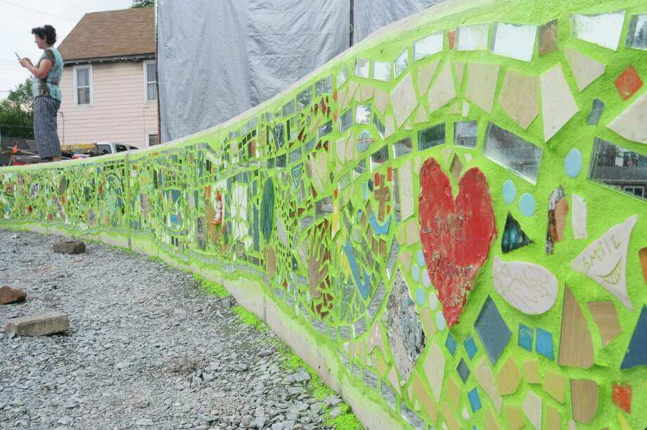 A view of the front of the stage with mosaic artwork at the Freedom Square Art Stage on Sunday, June 2, 2013 in Troy, NY.  The creation of the art stage and mosaic wall is a project being organized by the Media Alliance.  The alliance brought in mosaic artist, Isaiah Zagar from Philidelphia, PA, who worked with the community members building the mosaic on Saturday and Sunday.  The first musical concert on the stage will be held on June 15th, with a ceremony honoring those who took  part in building the mosaic.  The  Media Alliance is planning various community art projects for the summer.   (Paul Buckowski / Times Union) Photo: Paul Buckowski