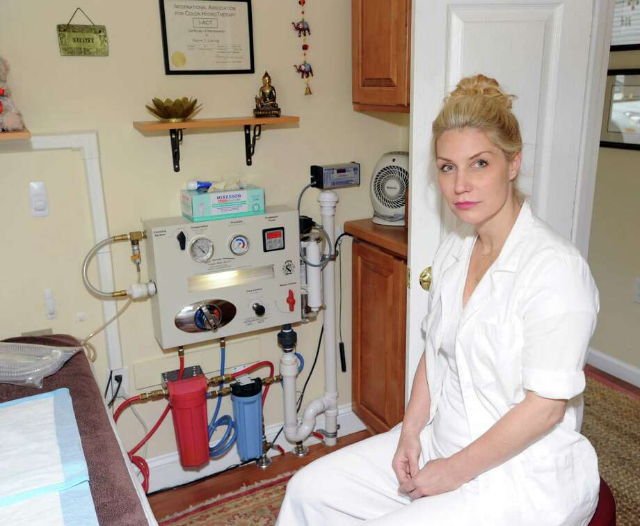 Karen Laessig, the owner and operator of Alaya Wellness Center, a colon hydrotherapy clinic, at her place of business in Cos Cob, Friday, May 24, 2013. The town is seeking to close Laessig's business. The town's position is that only licensed medical professionals should perform colonics.  Laessig is seeking relief from the General Assembly, which is considering a pair of bills that would create a list of certified colon-cleansing clinics in the state. Photo: Bob Luckey / Greenwich Time