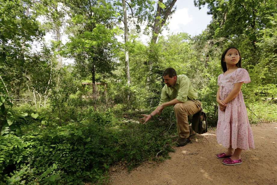 "Expert forager Mark Vorderbruggen and his daughter Kesa look for edible wild plants recently near the Houston Arboretum. ""The thrill of the hunt is one of the big attractions,"" he says. ""I'm always looking for the special new plant."" Photo: Â TODD SPOTH PHOTOGRAPHY, LLC / © TODD SPOTH PHOTOGRAPHY, LLC"