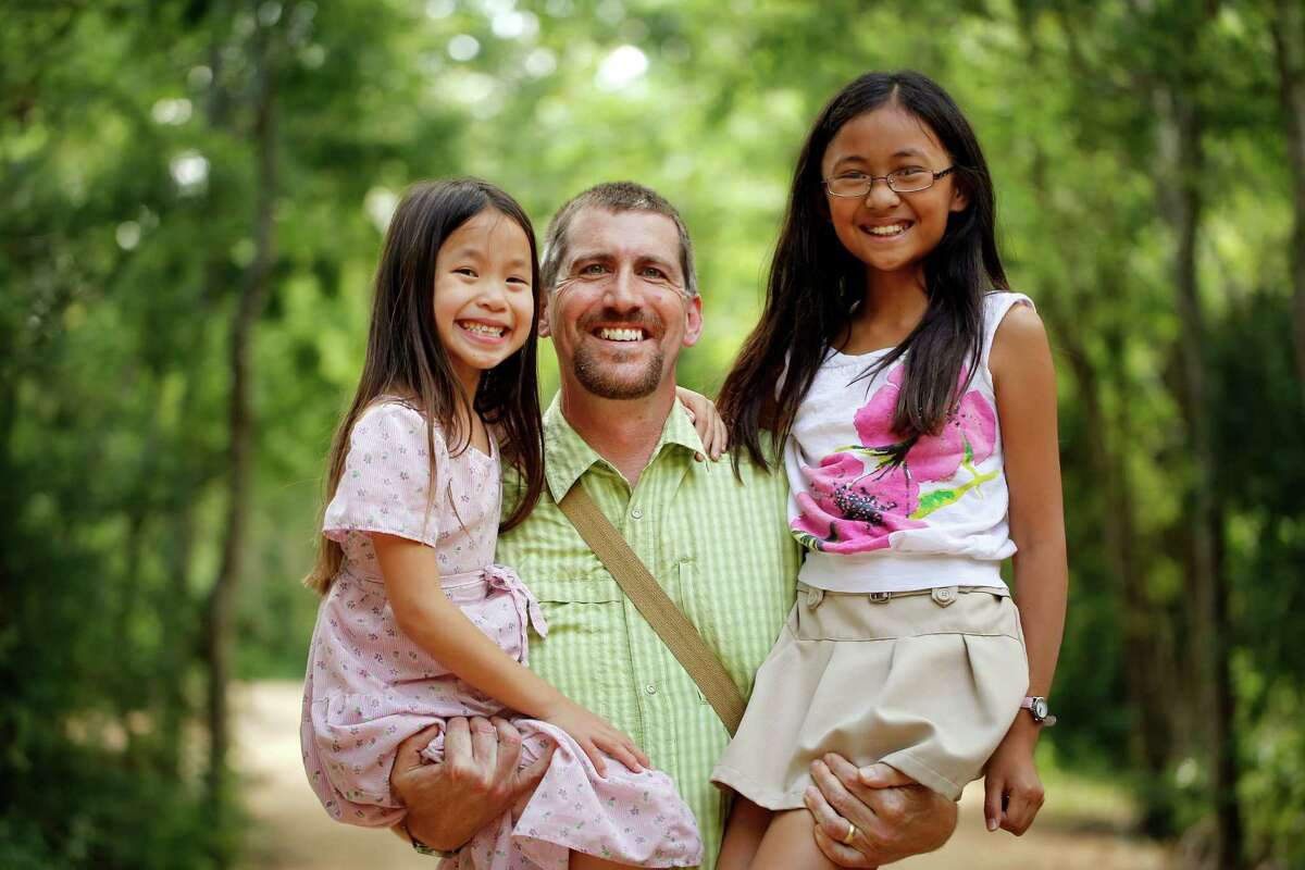 Chemist and foraging expert Mark Vorderbruggen gets help on forays from his daughters, 4-year-old Kesa, left, and 9-year-old Kiki.