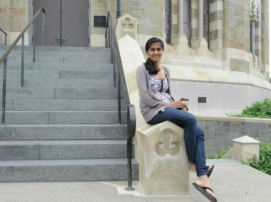 "Shilpa Darivemula sits in front of the Nott Memorial at Union College on Tuesday, May 28, 2013 in Schenectady, N.Y. Shilpa  got a $550 grant from the college to create her chaulk board ""Before I Die"" community art project that's based on a famous project done in New Orleans. (Lori Van Buren / Times Union) Photo: Lori Van Buren / 00022590A"