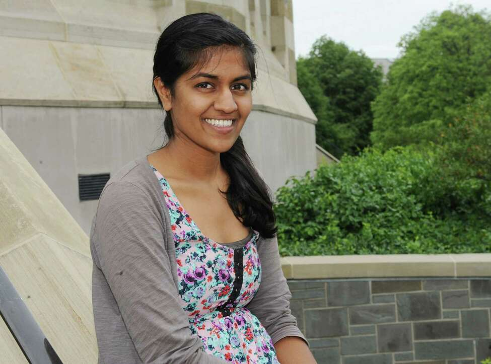 Shilpa Darivemula sits in front of the Nott Memorial at Union College on Tuesday, May 28, 2013 in Schenectady, N.Y. Shilpa got a $550 grant from the college to create her chaulk board