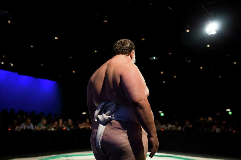 Sumo wrestler Kelly Gneiting awaits his next fighting round during LivingSocial's Sumo + Sushi tour Sunday, June 2, 2013, at Fremont Studios in the Fremont neighborhood of Seattle. Each date of the eight-city tour includes a three-course sushi meal and sake for attending guests. Photo: JORDAN STEAD, SEATTLEPI.COM / SEATTLEPI.COM
