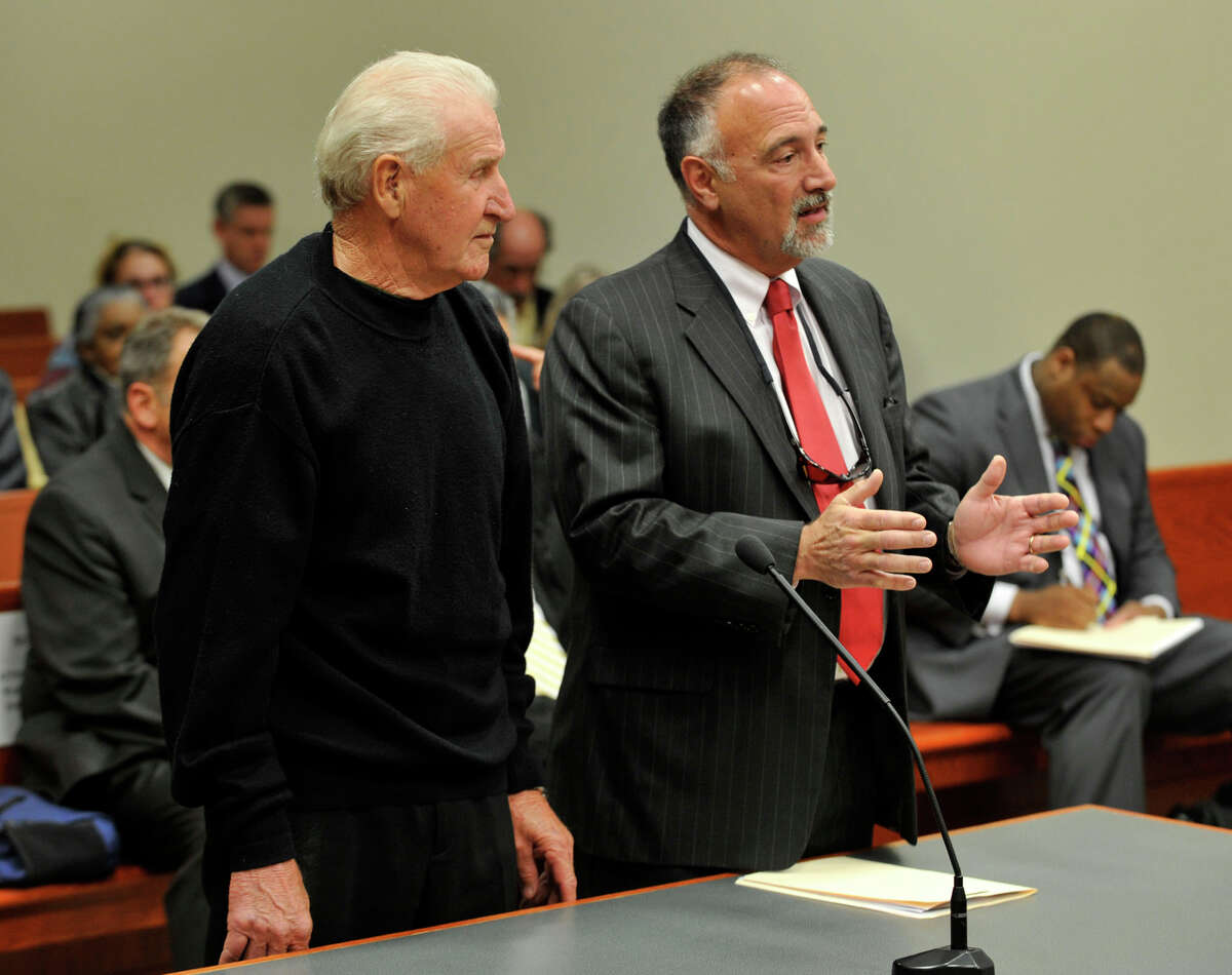 Dominic Badaracco, left, appearing with his lawyer Richard Meehan, enters a not guilty plea during Badaracco's arraignment at State Superior Court in New Britain on Wednesday, April 25, 2012. Badaracco, of Sherman, is accused of trying to bribe a judge in a grand jury case.