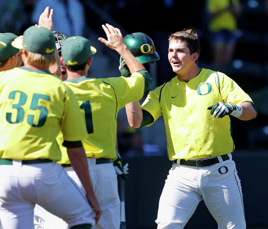 Ryon Healy, right, got the scoring carousel started early for Oregon against Rice, hitting a solo homer in the first inning of the Ducks' 11-0 victory at Eugene, Ore. Photo: CHRIS PIETSCH, FRE / FR24134 AP