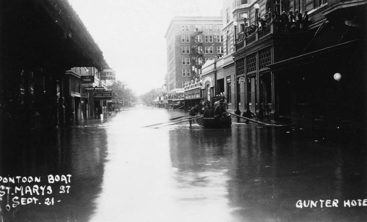 The Thrall Flood in 1921 drenched San Antonio due to a tropical storm that formed in the Bay of Campeche. In this photo from Sept. 21, 1921, soldiers float in a boat down St. Mary's Street. During 36 hours, the amount of rainfall stood at 39.7 inches, which drowned 51 people.