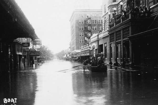 Soldiers float in a boat down St. Mary's Street on Sept. 21, 1921, during a flood that left 50 people dead.