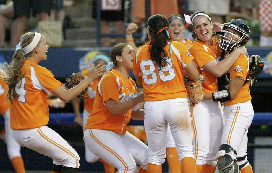 Tennessee players celebrate their 2-1 victory over Texas in the Women's College World Series. The Longhorns finished the season 51-10, the second-best record in school history. Photo: Alonzo Adams / Associated Press