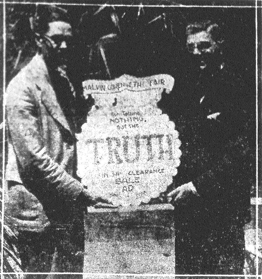 "Jack Millburg, president of the San Antonio Advertising Club, and Malvin Cohen, manager of the Fair Store, holding the mammoth medal awarded to the Fair Store for its unique advertisement which was printed in the Evening News yesterday. One dirty wedding dress. This was one of the items of the advertisement which created a mild sized sensation from the moment it appeared and which was the means of jamming the Fair Store today with shoppers. The advertisement, entitled ""The Fair's Follies"" was based on truth ""Even in confessing out mistakes."" The dirty wedding dress mentioned in connection with more than a half hundred other articles almost caused a stampede so great was the demand for it. Taking cognizance of the advertisement, the San Antonio Advertising Club awarded Manager Cohen a large sized medal. The ""ad"" was Mr. Cohen's idea, and it was carried out by Edward Decker, advertising manager of the store. Published in the San Antonio News June 15, 1928. Photo: File Photo"
