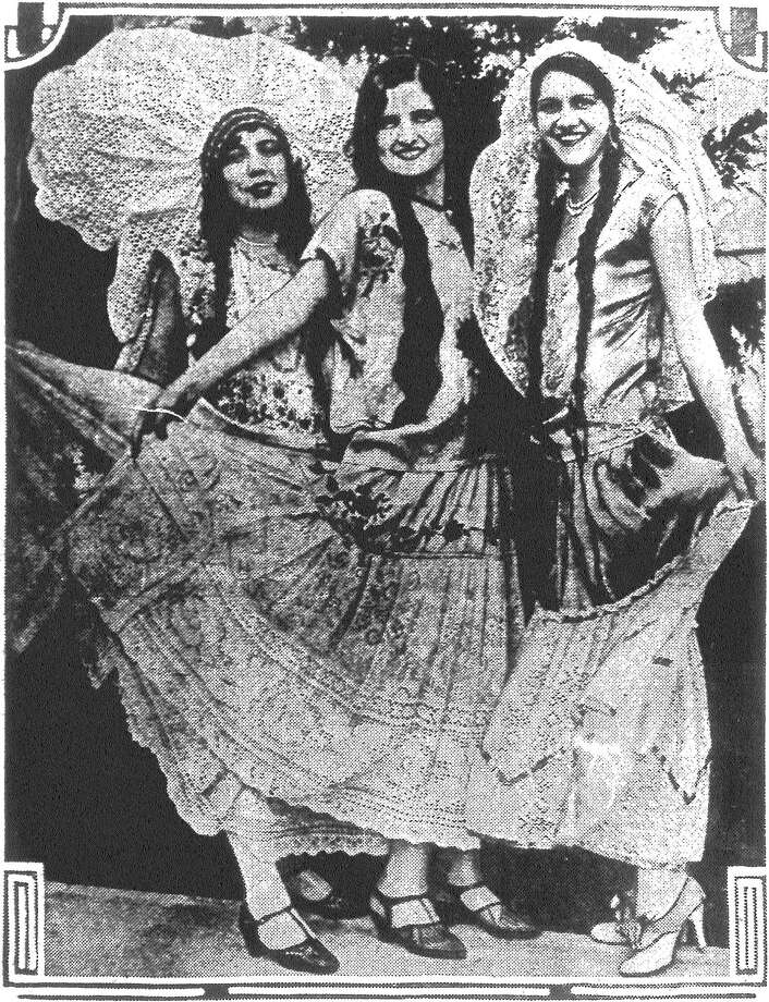 Left to right, Dolores Castanola, Margarita Sanchez, Gloria Urrutia, in Spanish costume, are ready to help entertain delegates to the Junior Chamber of Commerce convention in San Antonio this week. Published in the San Antonio Light June 13, 1928. Photo: File Photo