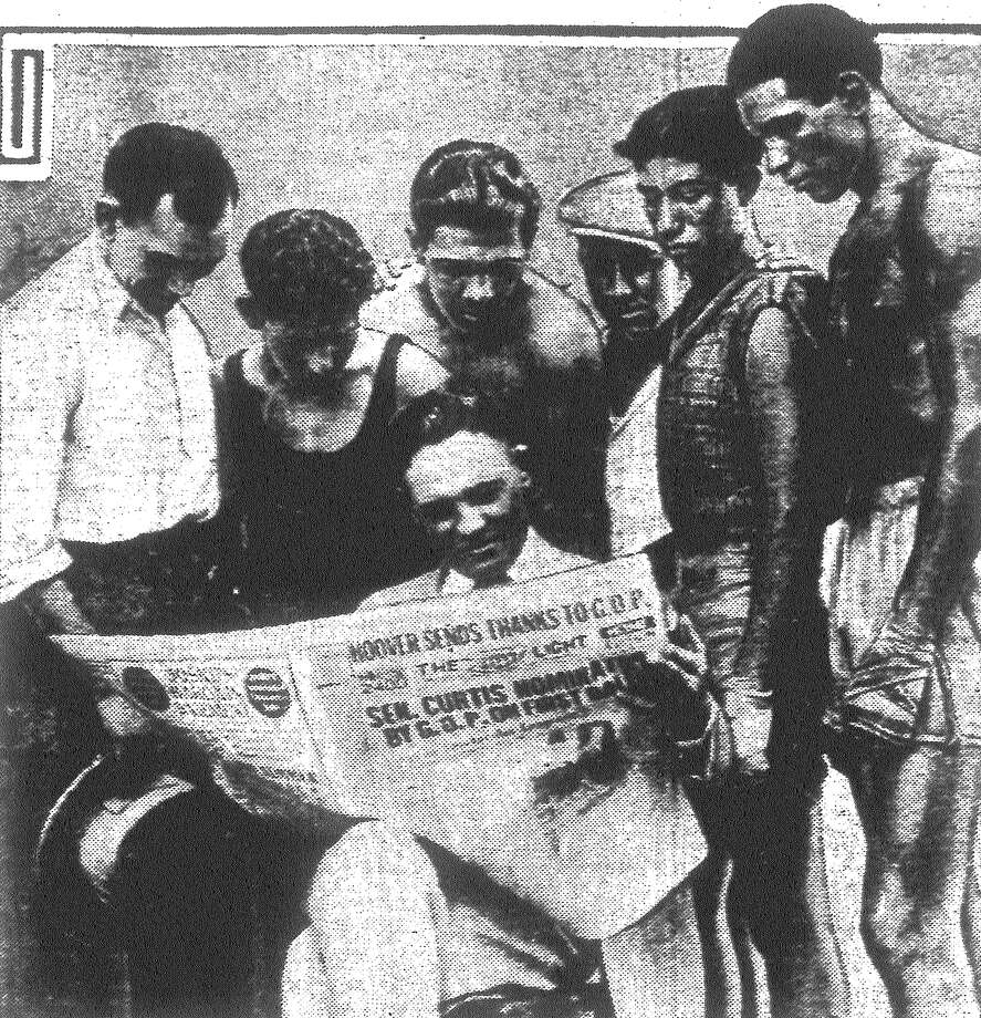 "The Light is delivered at the Business Men's A.C. Gym and the boys gather around to read ""The Assassin,"" the Stanley Ketchel serial, over the shoulder of Promoter Jack Shelton. Left to right, Nobe Cervantes, Hill Hernandez, Kid Gilbert, Rocky Kansas, Danny Perez and Kid Herrera. Published in the San Antonio Light June 18, 1928. Photo: File Photo"