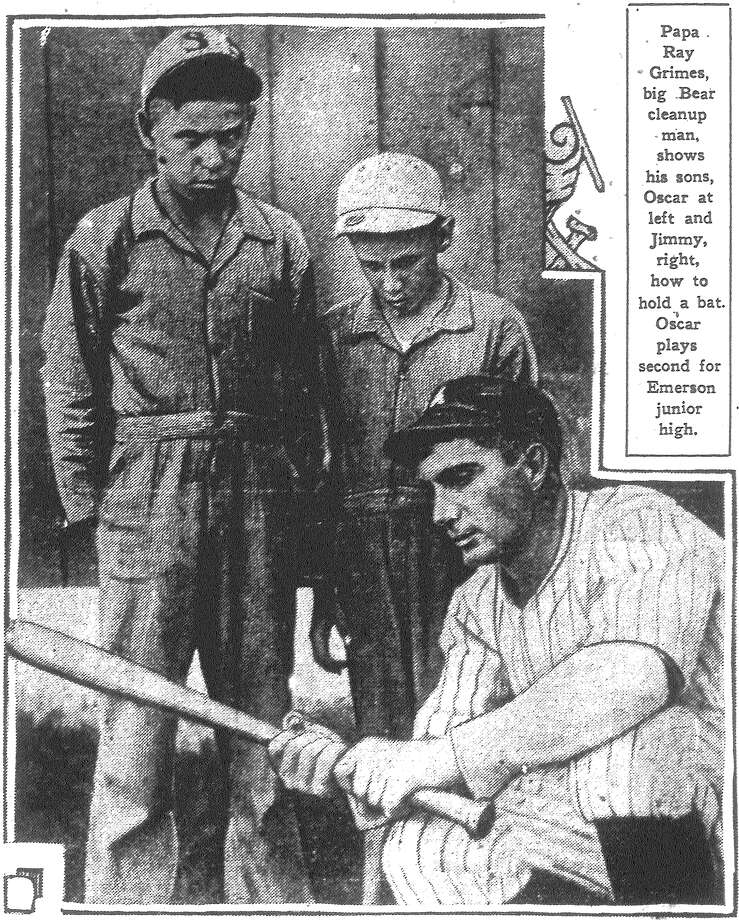 Papa Ray Grimes, big cleanup man for the San Antonio Bears, shows his sons, Oscar at left and Jimmy, right, how to hold a bat. Oscar plays second for Emerson Junior High. Published in the San Antonio Light June 17, 1928. Photo: File Photo