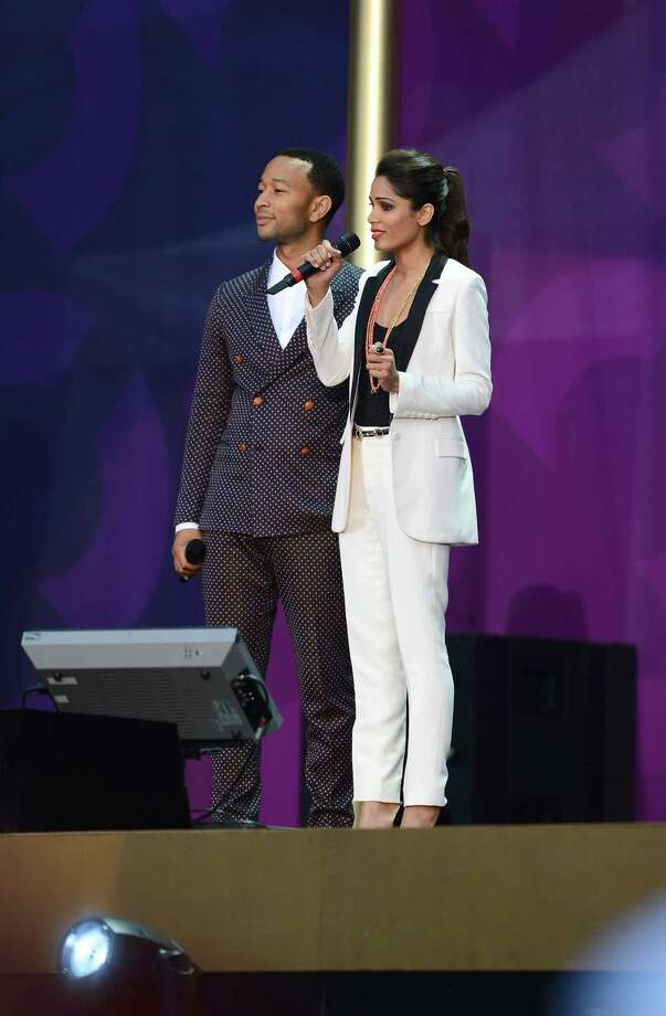 "John Legend and Freida Pinto speak on stage at the ""Chime For Change: The Sound Of Change Live"" Concert at Twickenham Stadium on June 1, 2013 in London, England. Chime For Change is a global campaign for girls' and women's empowerment founded by Gucci with a founding committee comprised of Gucci Creative Director Frida Giannini, Salma Hayek Pinault and Beyonce Knowles-Carter. Photo: Ian Gavan, Getty Images For Gucci / 2013 Getty Images"