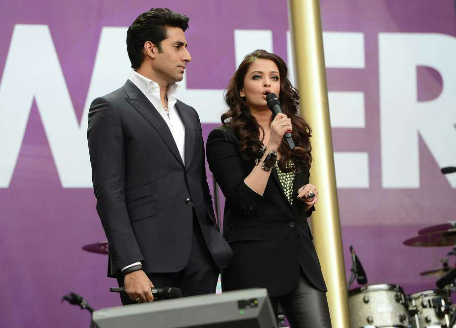 "(L-R) Abhishek Bachchan and Aishwarya Rai Bachchan speak on stage at the ""Chime For Change: The Sound Of Change Live"" Concert at Twickenham Stadium on June 1, 2013 in London, England. Chime For Change is a global campaign for girls' and women's empowerment founded by Gucci with a founding committee comprised of Gucci Creative Director Frida Giannini, Salma Hayek Pinault and Beyonce Knowles-Carter. Photo: Ian Gavan, Getty Images For Gucci / 2013 Getty Images"
