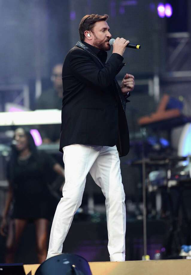 "Simon Le Bon  performs on stage at the ""Chime For Change: The Sound Of Change Live"" Concert at Twickenham Stadium on June 1, 2013 in London, England. Chime For Change is a global campaign for girls' and women's empowerment founded by Gucci with a founding committee comprised of Gucci Creative Director Frida Giannini, Salma Hayek Pinault and Beyonce Knowles-Carter. Photo: Ian Gavan, Getty Images For Gucci / 2013 Getty Images"