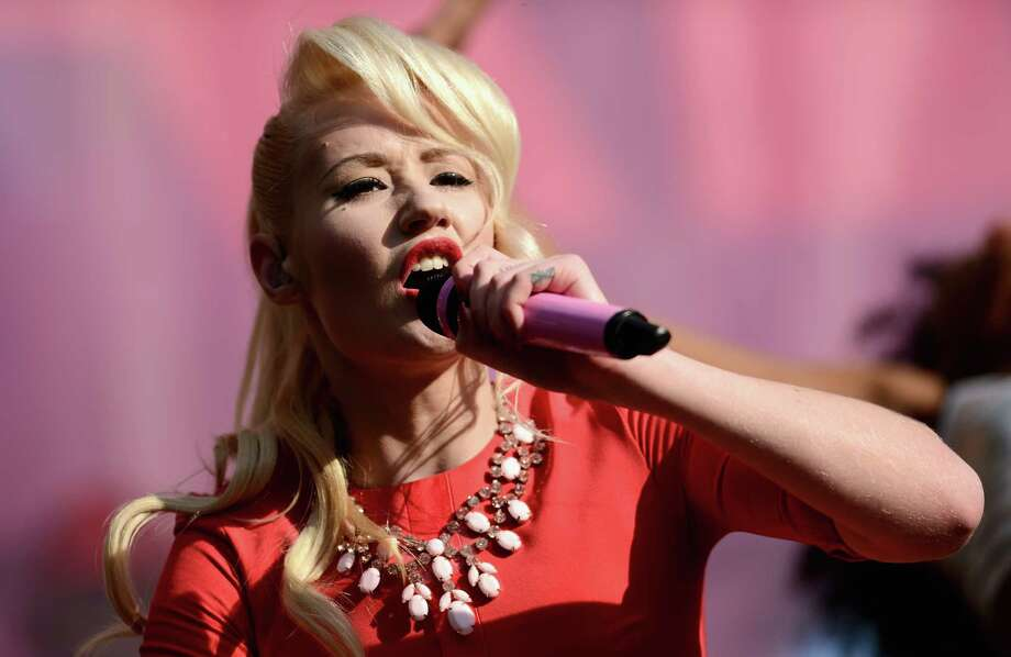 """Singer Iggy Azalea performs on stage at the """"Chime For Change: The Sound Of Change Live"""" Concert at Twickenham Stadium on June 1, 2013 in London, England. Chime For Change is a global campaign for girls' and women's empowerment founded by Gucci with a founding committee comprised of Gucci Creative Director Frida Giannini, Salma Hayek Pinault and Beyonce Knowles-Carter. Photo: Ian Gavan, Getty Images For Gucci / 2013 Getty Images"""